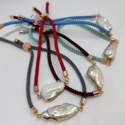 Huge pearl in silky bracelet