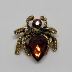 Golden spider brooch